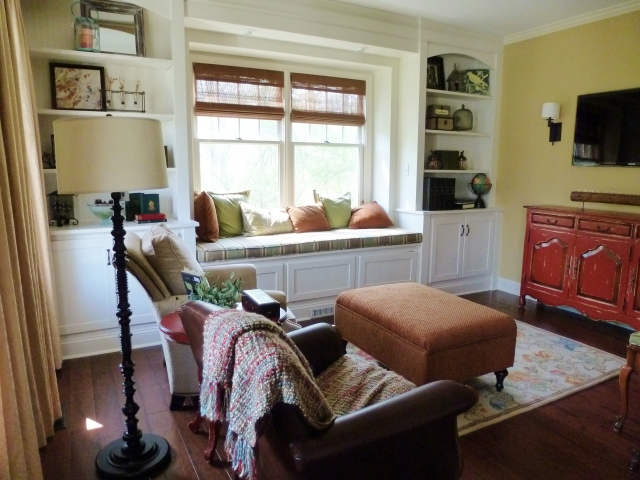 The area rug was our color inspiration in this room.  The ottoman fabric, pillows, seat cushion and even painted furniture all were selected from colors in the rug.