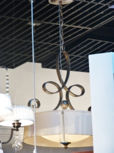 An absolutely gorgeous chandelier we chose for above the dining table.  It boasts a metal scroll/calligraphy detail with a glass bowl hidden under a linen barrel shade.