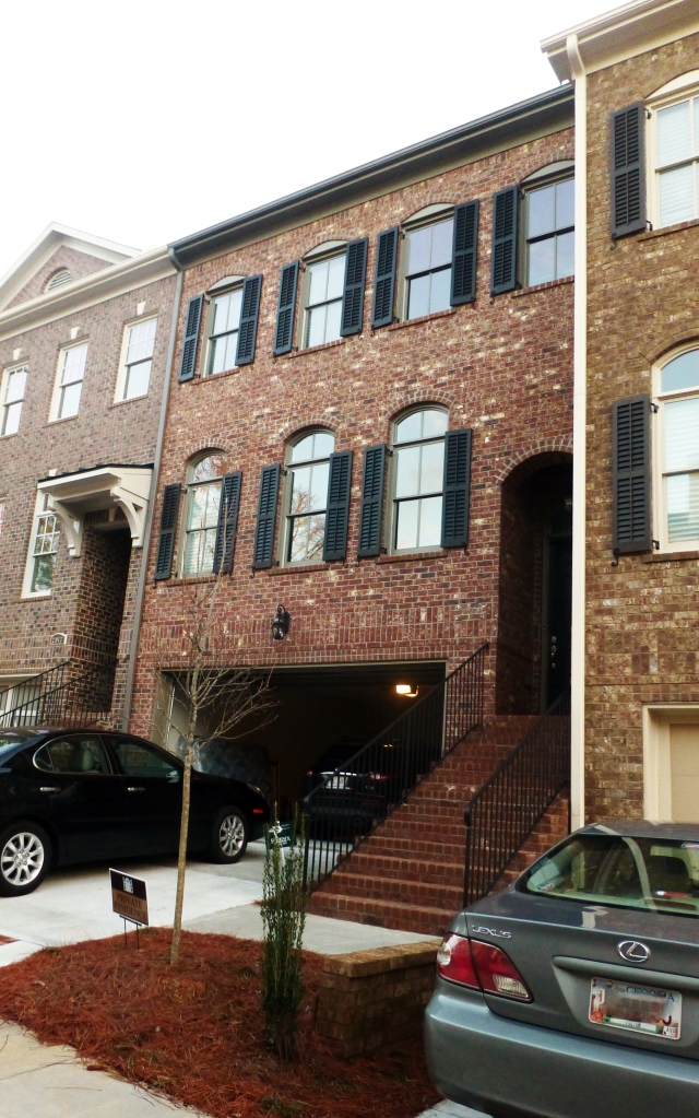 The all brick townhouse is 4 bedrooms, 3.5 baths and approximately 3,000 square feet.