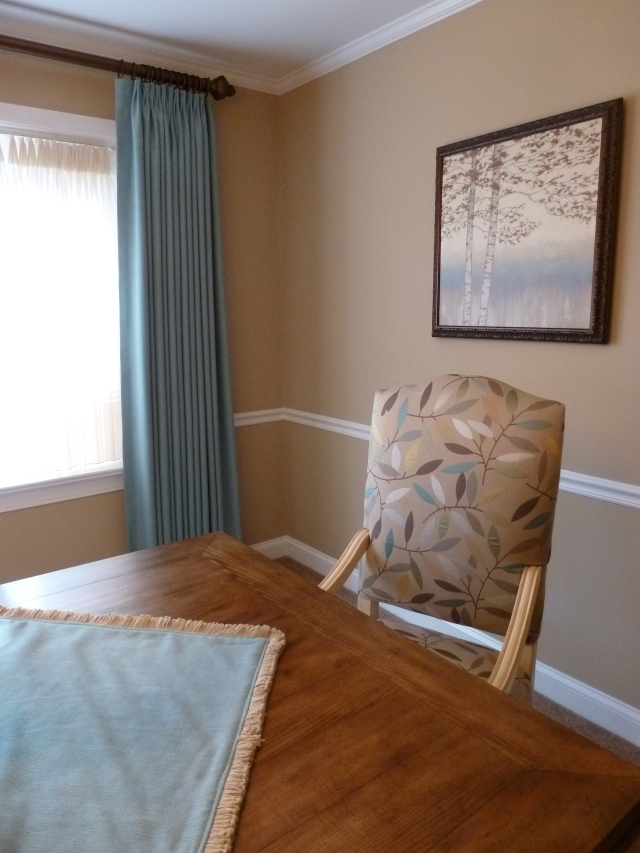 The dining chair fabric drove our color selections in this dining room.  The wall color, table square, and drapery fabrics were all selected from colors in this fabric.