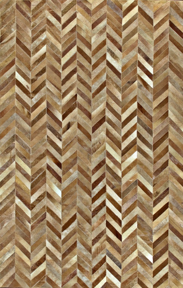 An amazing 8x10 area rug made from strips of cowhide, sewn together in a herringbone pattern.