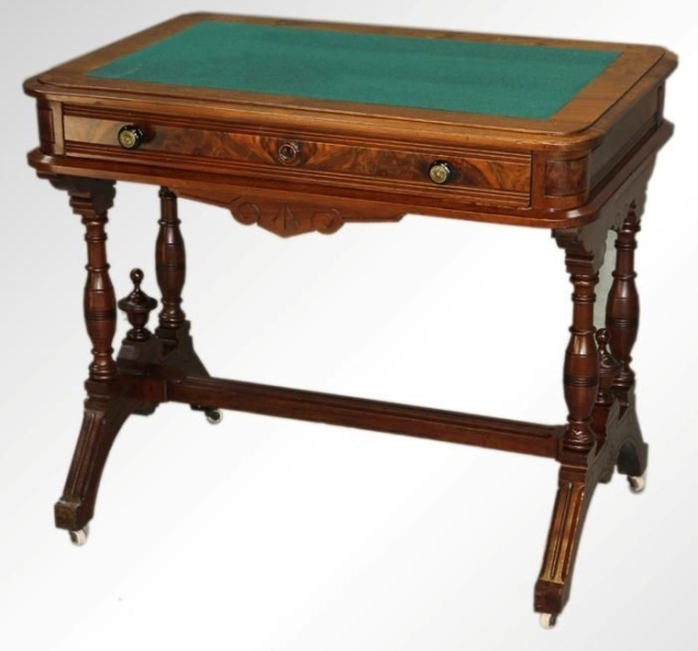 A Victorian writing desk, similar to the one shown here, will be used in the corner, facing outward to maximize the view.