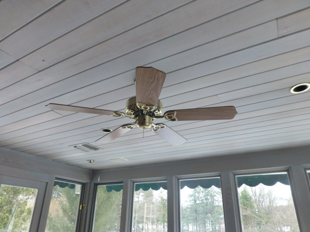 The dated ceiling fan will definitely have to go, but check out the lovely stained woodwork.  I really like the gray, don't you?