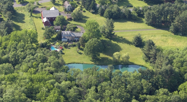 Serendipity Farm as seen from Above, with its beautiful barn, cottage, and pond.  The grounds are just amazing at this year's property!