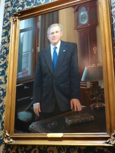 This portrait of President Bush hangs over the mantel in the U.S. President's gallery.  It is unbelievably life-like and looks like a photograph!