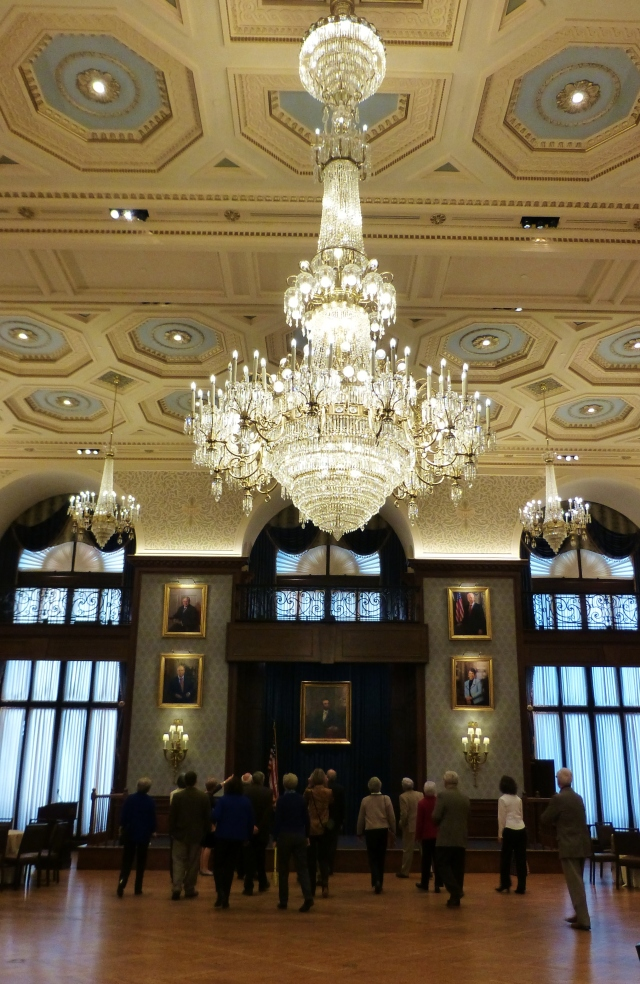 The monumental chandelier in this room almost distracts from the paintings of past club presidents that hang nearly to the ceiling.