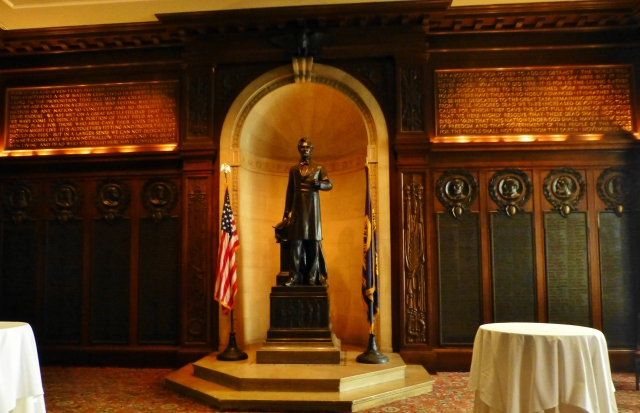A small dark-paneled library has a statue of Abraham Lincoln and the Gettysburg Address carved into the woodwork and gilded.