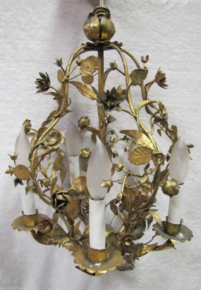 I found an adorable vintage chandelier, similar to this one, but with the cutest glass acorns dangling from the gold leaves.   It will look terrific hanging above a small table next to the Duchesse Brisee!