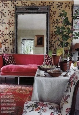 A colorful pink sofa with a large mirror used behind it is very similar to the statement pieces in my Bucks County Designer House sunroom.