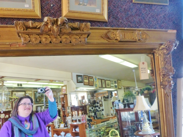 Here I am, taking a snap shot of the fantastic Victorian gold mirror I found at Mr. Jim's Furniture & Antiques.  You can see some of their wonderful inventory behind me, reflected in the mirror.