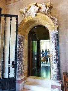 The entry boasts marble columns and carved stone-work.  Very distinctive!