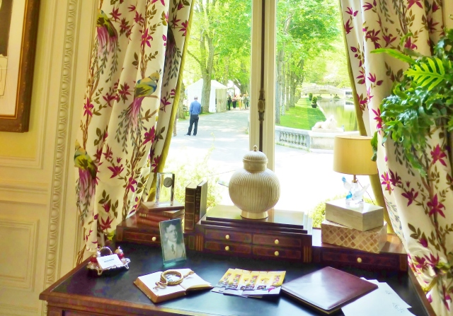 The petite writing desk is positioned at the window (Just as I like it!).  The view is of the long pond at the entrance to the home.