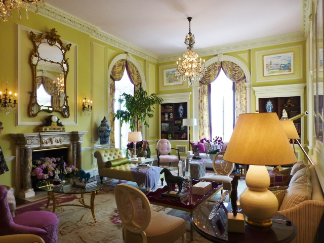 Mrs. Blair's Drawing room is a colorful exotic retreat.   The chartreuse walls invigorate the space with a spring-time feel and the colorful fabrics are so youthful and vibrant!