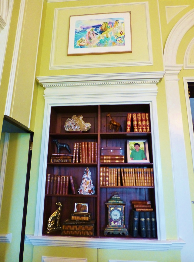 The built-in bookcases are filled with luxurious antique books (a favorite of mine) and lovely accessories.  You can also see the detail of layered color on the walls and trim in this photo.