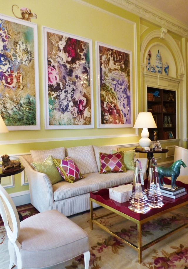 Light neutral sofas and chairs are combined with bold pillows and contemporary artwork.