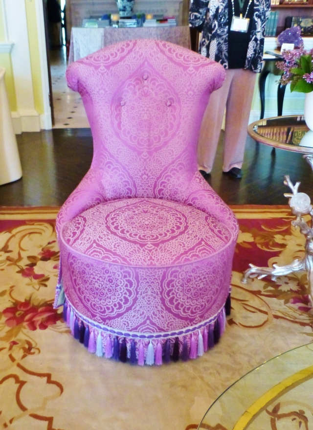 I adore this 'Radiant Orchid' slipper chair near the entrance to the room.  It becomes sculpture, floating near the fireplace.  Don't you just love its curvy lines, saturated colorful fabric, and the fabulous fringe at the base?!