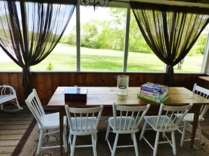The screened porch is perfect for playing games and watching the scenery.  Farm living at its best!