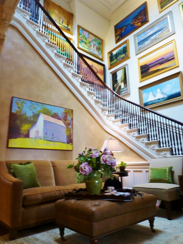 I loved this space for its bold colorful artwork.  The neutral walls and furnishings created a terrific backdrop for the saturated colors in the many paintings.