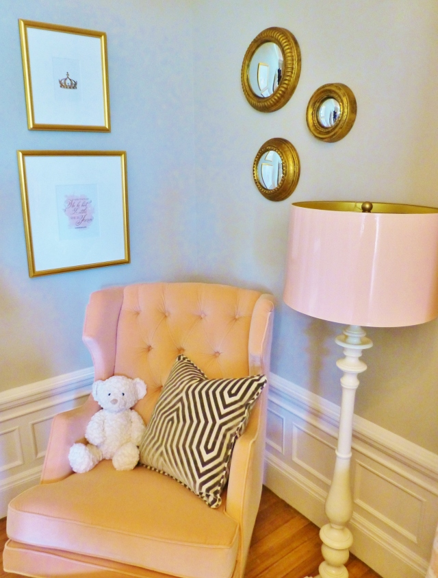 Notice the high-gloss pink lampshade on the floor lamp and the very cool artwork and circular mirror grouping.  I also especially like the geometric fabric on the custom pillow...definitely not your average, run-of-the-mill baby's room!