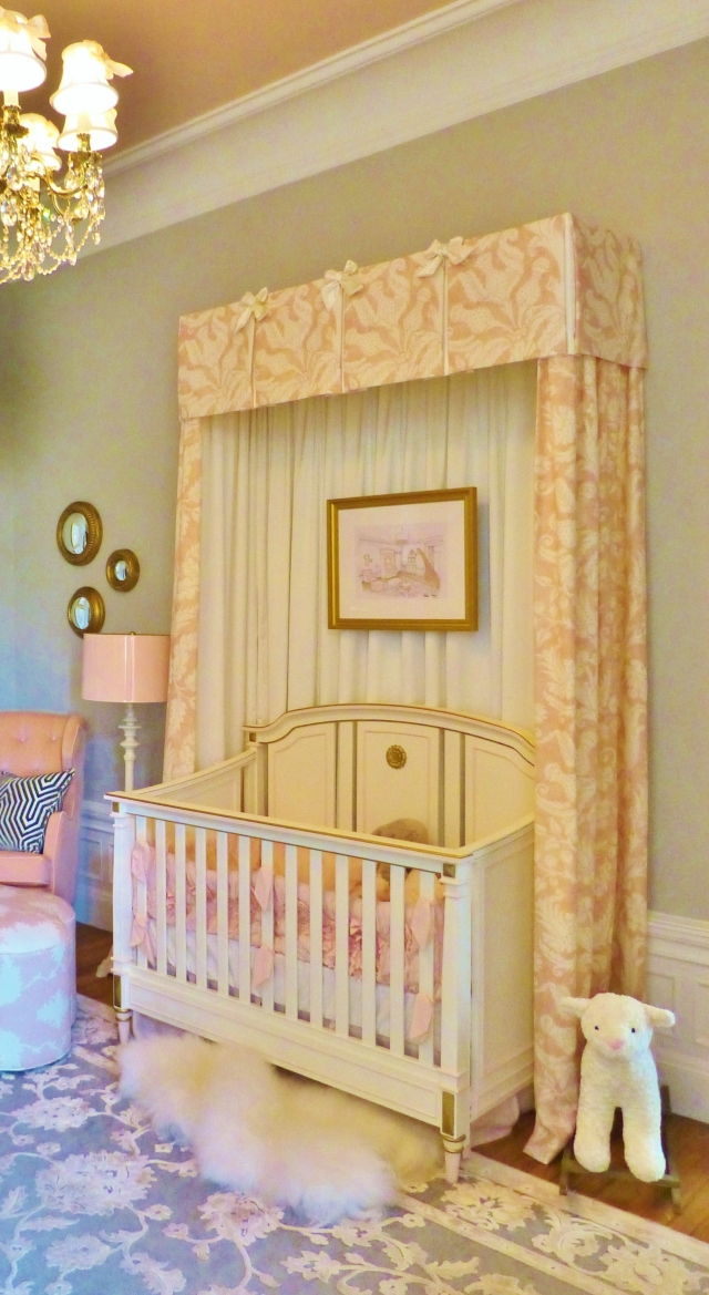 A detail of the stunning canopy surrounding the precious white crib.  The artwork hung inside the canopy is the designer's rendering of this stunning nursery.