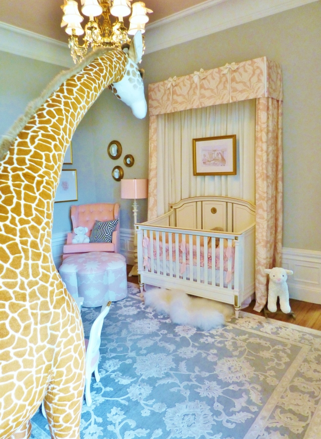Not to be missed in a far corner of the room is a nearly life-sized stuffed animal giraffe!!  He's just the playful whimsical touch this little girl's room needs.