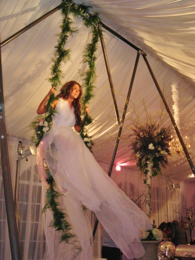 In 2008 I attended a gala at Cairnwood, during which costumed performers sat high above the crowd and whimsically swung back and forth all evening...it certainly set a fabulous mood.  What an amazing event that was!