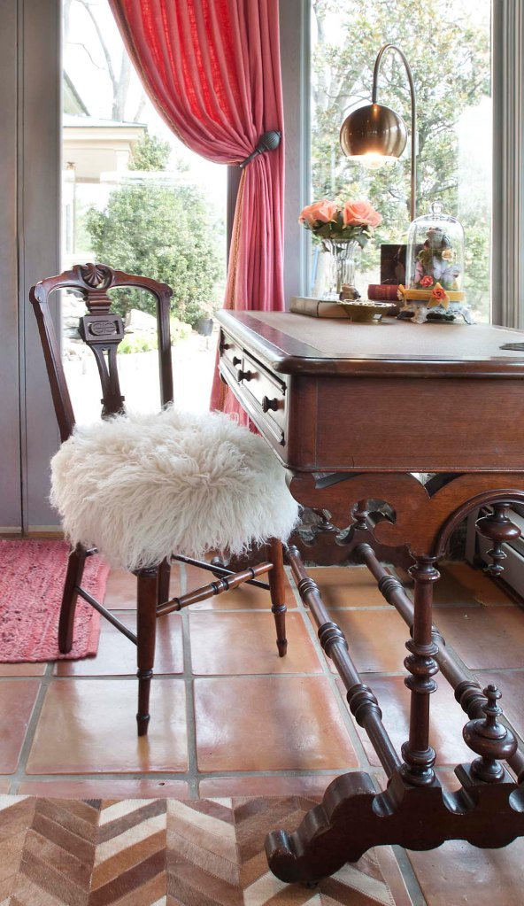 Here's a detail view of the desk, and the adorable Victorian chair with its flokati wool covered seat.  I also love the modern lamp and the Victorian style cloche on the desk.
