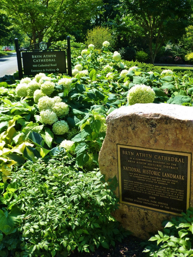 This stone is positioned amongst lovely plantings at the entrance to the Bryn Athyn Cathedral.  The bronze plaque commemorates the prestigious National Historic Site designation.