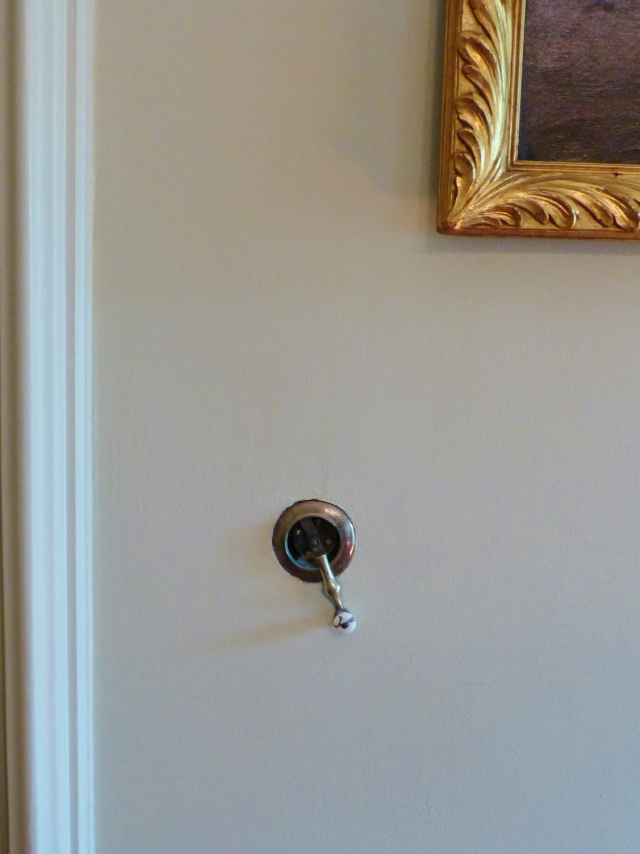 Remember this image from the Study down the hall?  It shows the crank for the call system.  A simple turn of the handle would summon one of the three live-in domestic servants at the Ebenezer Maxwell Mansion.