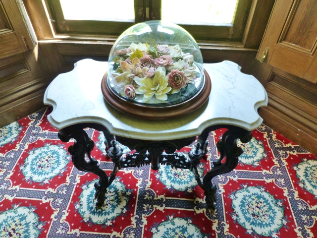 The bay window features an absolutely stunning Rococo Revival style marble-topped table.  On top of the marble-topped table is a splendid Victorian Cloche (glass dome) featuring an arrangement of sea shells artfully arranged in the shape of flowers. Isn't it so beautiful and amazing!