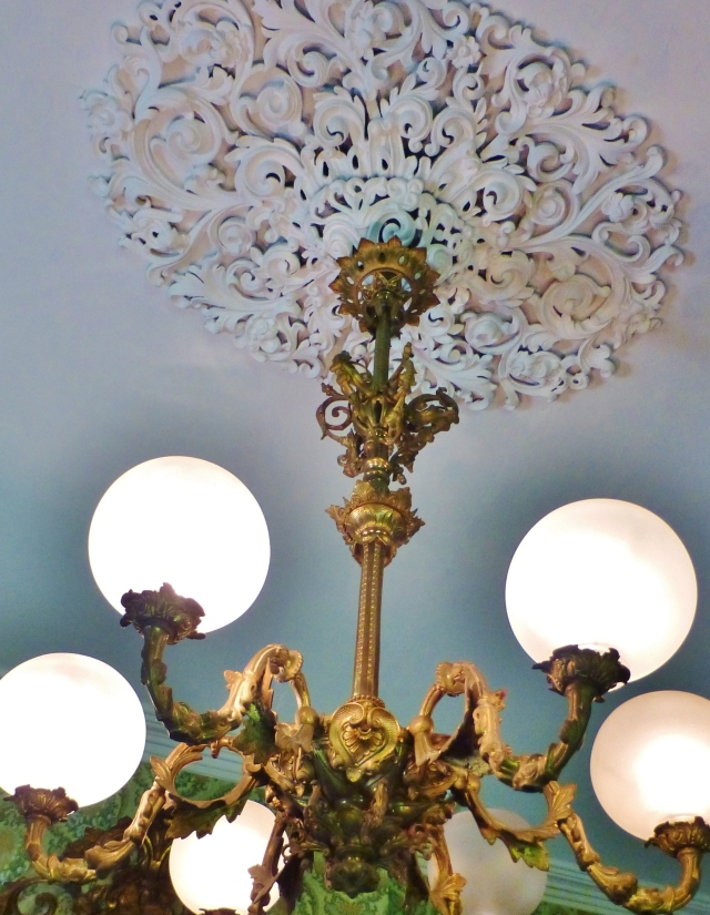 A detail of the opulent chandelier and ceiling medallion in the parlor at the Ebenezer Maxwell Mansion.