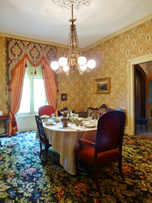 A final view of the dining room, with its table set for a sumptuous Victorian dinner.
