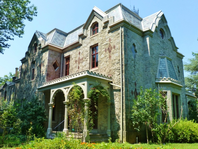 The back porch is actually slightly larger than the front porch and has a lovely view of the rear garden.  You can also see the bay window on the side of the mansion, which is a prominent feature of the main parlor inside the house.