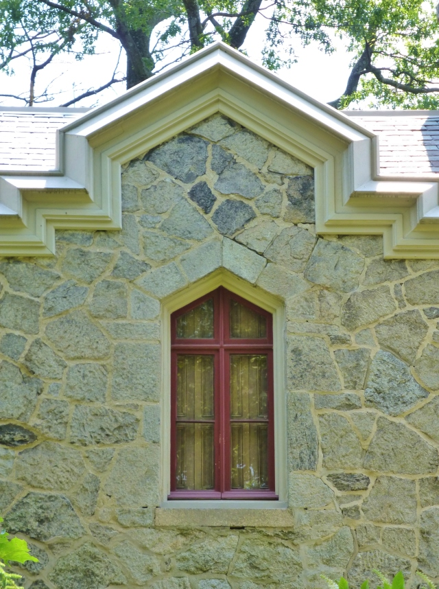 Here's a window with a peak or Gothic arch.  I admire the red window trim color too...very authentic!