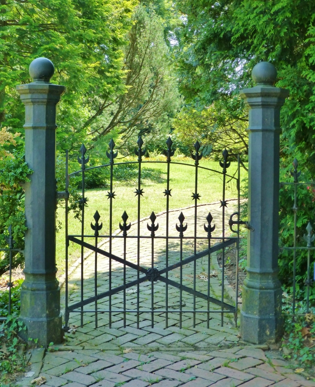 The original fence surrounding this corner property is also quite lovely.  Can you see the spiky starburst portion partway down the gate?  This wrought iron has such great detail.