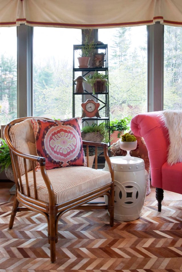A pair of vintage rattan chairs were re-worked to provide a comfortable perch in the main seating area.  The Ikat pillows were an important part of my color-scheme inspiration.  I used this great metal display ladder in the center of the room to display accessories and plants (mainly succulents).  A garden stool provides a convenient space for drinks.