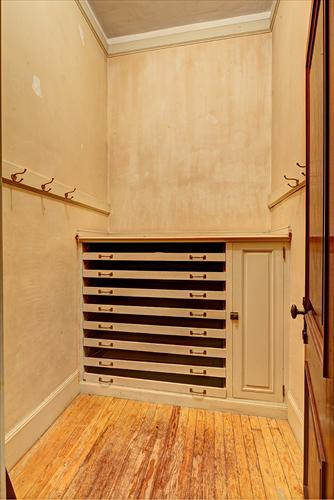 Check out the before image of the linen closet on the second floor of Blairsden.  This designer is a genius!