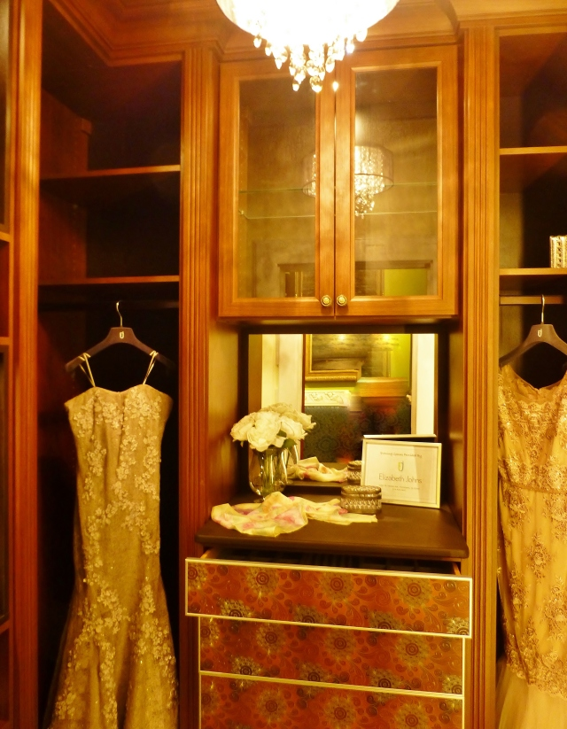 At first glance, this is just your average dark wood closet (and I must apologize, because my photograph does not do it justice).  On further inspection, you'll notice the drawers are just amazing.  They feature a Sirocco pattern printed on mirrored panels--very glam.  The gowns in this space were also magnificent--how luxurious to have a closet designated just for evening gowns!