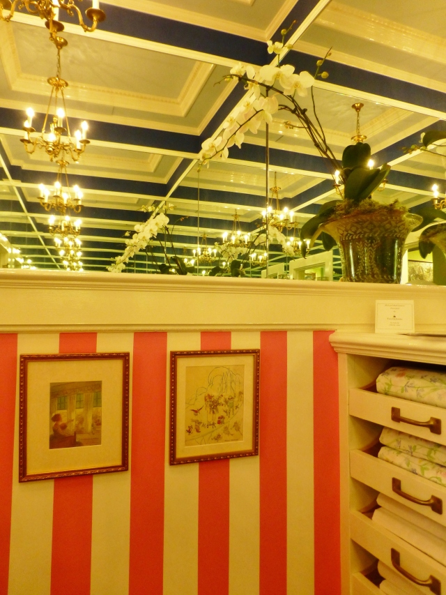 Here's another detail, showing the wide pink awning stripe adjacent to the pull-out shelves for storing linens.  What a fantastic closet, featuring the illusion of never-ending space.