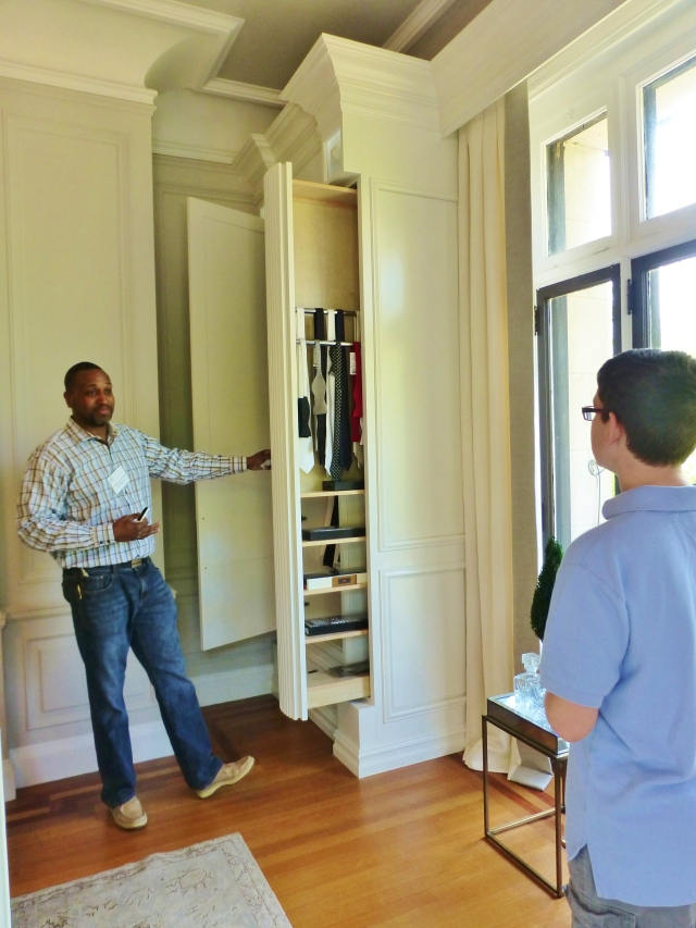 Devoe Martin from Affordable Closets Plus shows Grady the innovative storage solutions for gentlemen's ties and accessories.