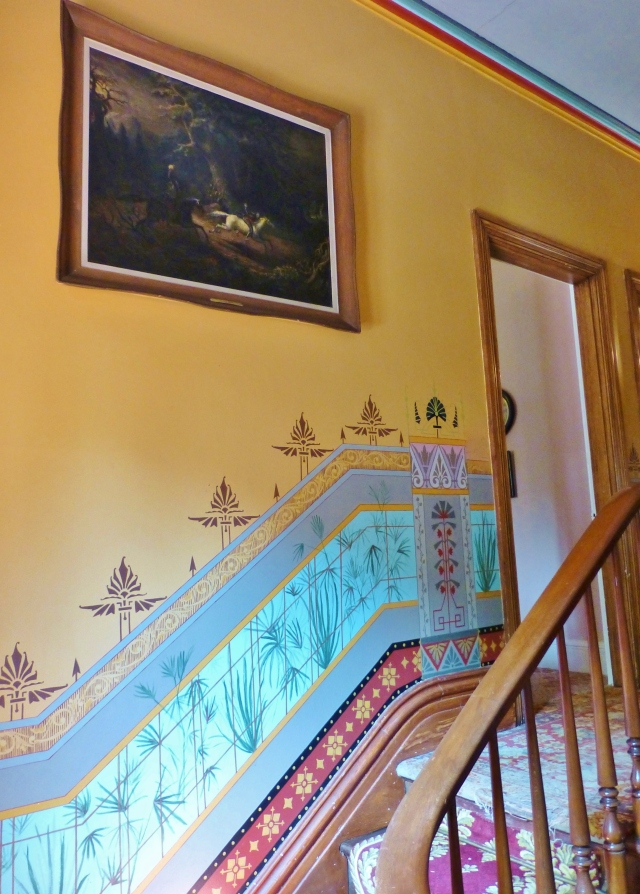 As we ascend the stairs from the foyer, a beautiful handpainted wainscoting takes shape on the landing. This colorful painting is in the style of the Aesthetic Movement with a little Asian influence thrown in.   The detailed painting has been restored exactly as the original, a portion of which is on view behind plexiglass in the upstairs hallway.