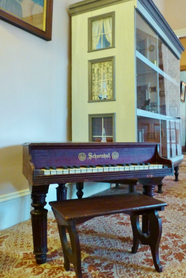 On our way out of the room is this lovely child-sized Schoenhut baby grand piano.  Did you know there are groups of people who write and record music specifically for these tiny pianos?  The children in this household were very fortunate...let's check out that humongous dollhouse next!