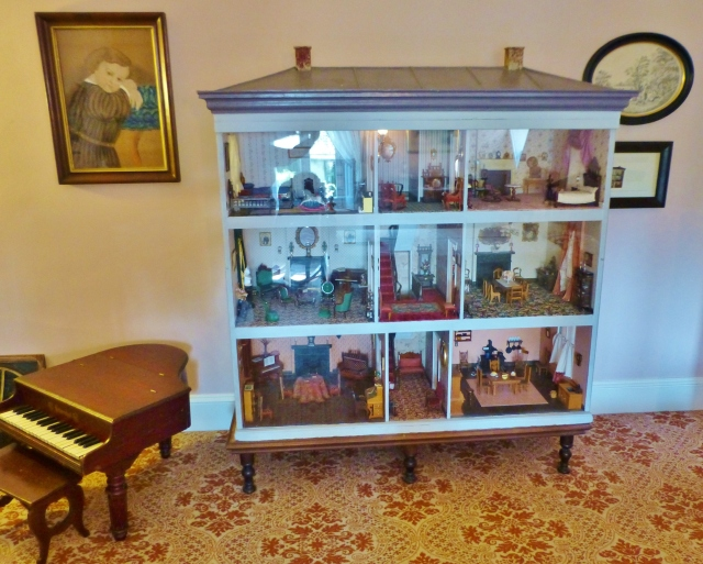 Here you see the quite large (around 5 foot tall) dollhouse, filled with antique miniature furnishings.  Sorry about the glare, but the museum keeps plexiglass on the front for obvious reasons--who could resist reaching a hand inside to play with these little masterpieces?