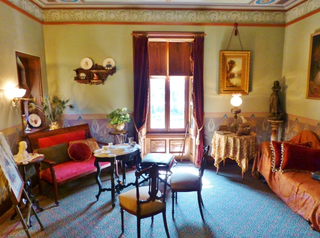 The right hand corner of the room features a chaise draped with a Paisley Shawl (very trendy at the time) and the left corner is set up for tea.