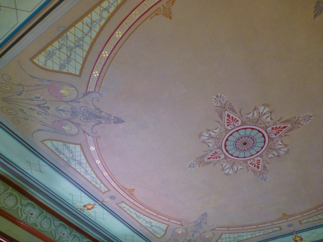 The ornate painted and gilded ceiling in the ladies lounge at the Ebenezer Maxwell Mansion.