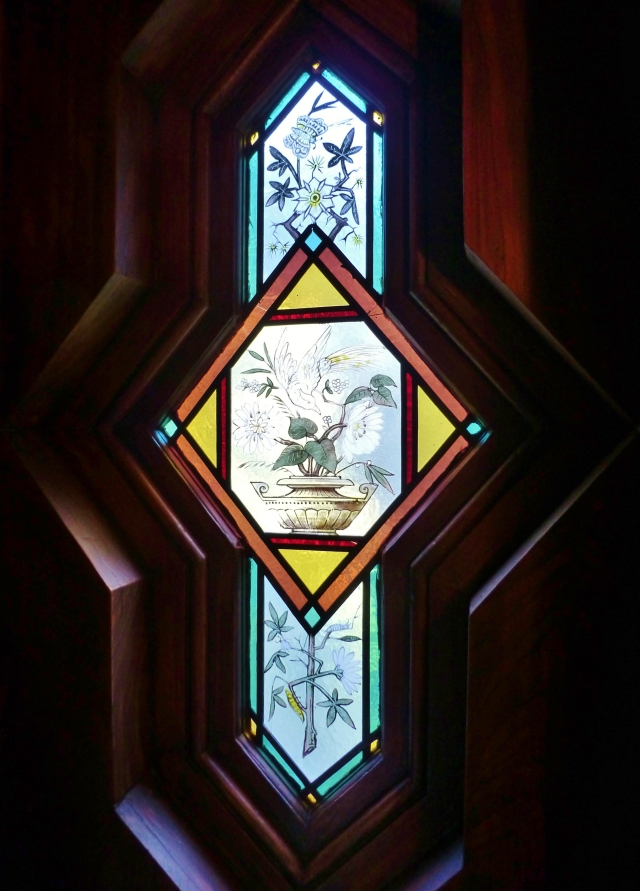 I managed to get a close-up of the phenomenal hand painted stained glass window (there's another one in the lounge).  The shape and color of these is truly stunning!  They feature botanicals with birds and insects.