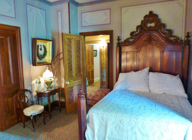 If you turn around and look back towards the entrance, you'll notice the Rococo Revival Headboard (it's much more curvy than the Renaissance Revival style furnishings) and the Candlewick bedspread (which was popular at this time).