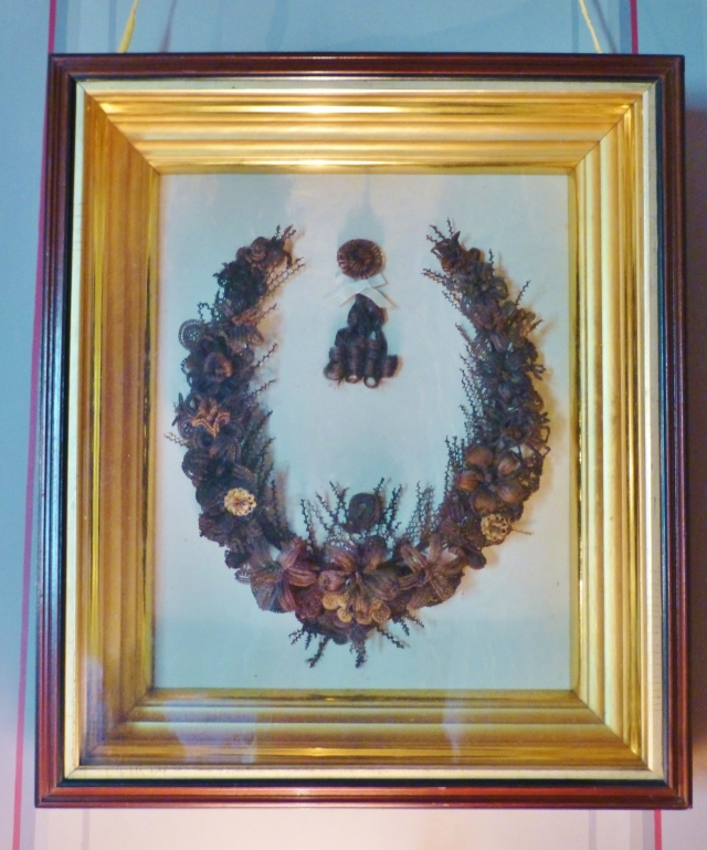 An intricately woven bouquet composed entirely of human hair hangs in the master bedroom at the Ebenezer Maxwell Mansion.  These hair wreaths were very popular in Victorian times, and the process of mounting the strands onto wirework frames was an acceptable pastime for Victorian ladies.