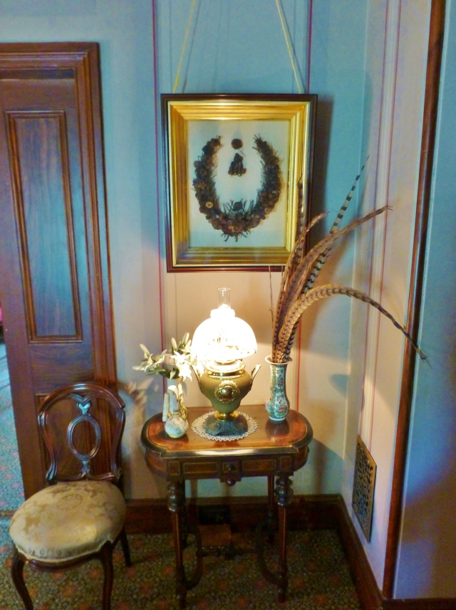 The corner to the left of the bed houses a charming little table and chair.  My favorite thing hangs above the table...