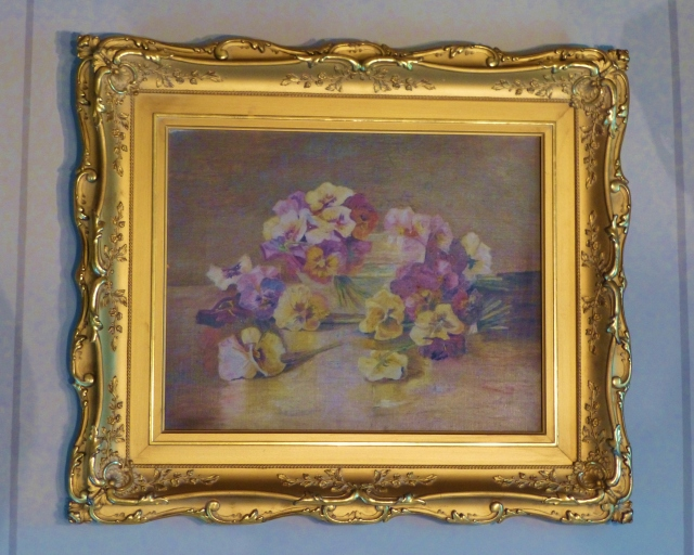I find this charming oil painting of pansies particularly attractive.  The Victorians loved painting still-life flowers and fruit like this.  What a great gilded frame it has too!